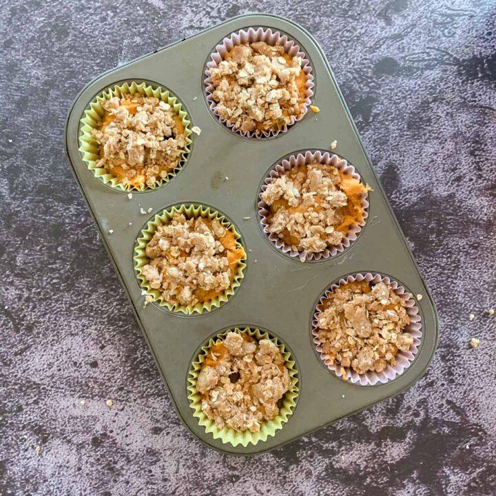 streusel cake mix pumpkin muffins in a pan